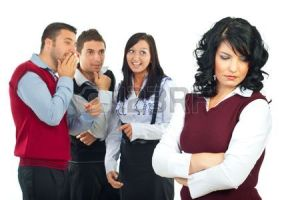 7907927-three-people-gossip-and-joke-in-background-about-their-colleague-woman-and-she-standing-with-hands-c